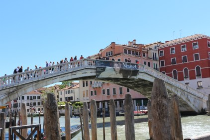 Over Ponte D Scalzi, enthusiastic tourists taking in the beautiful scenary on both sides of the bridge.