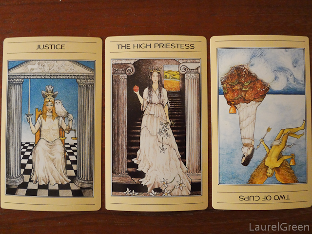 a three card tarot spread with just,, the high priestess and the two of cups reversed