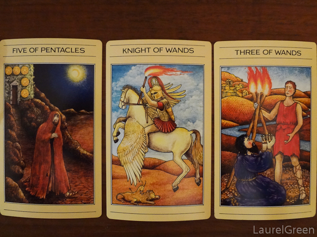 a three card tarot spread with the five of pentacles the knight of wands and the three of wands