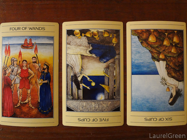 a three card tarot spread with the four of wands, the five of cups reversed and the six of cups reversed