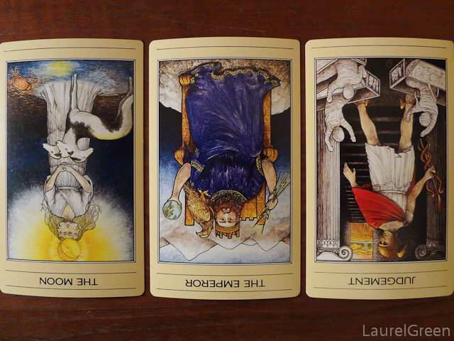 a three card tarot spread with the moon reversed, the emperor reversed and judgement reversed