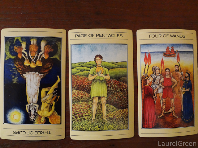 a three card tarot spread with the three of cups reversed, the page of pentacles and the four of wands