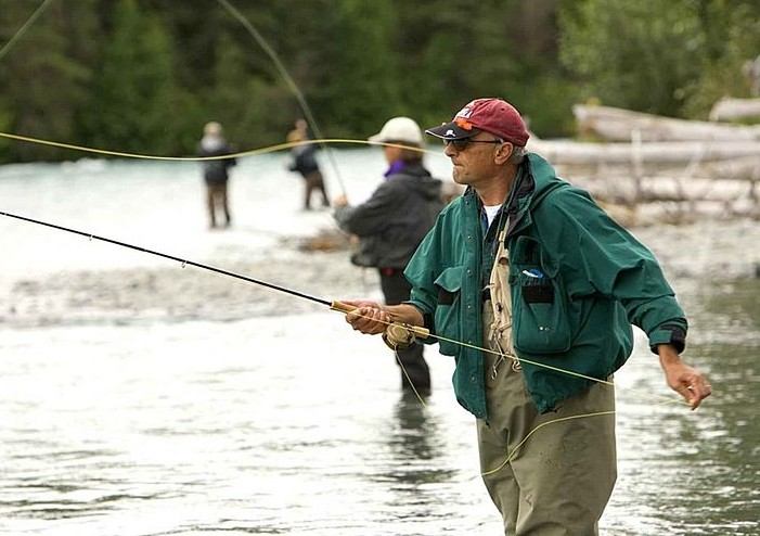 fly fishing in wader photo