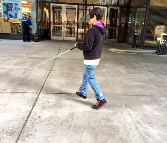 Image of Leanne DeIuliis walking through downtown Minneapolis