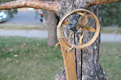 A wooden lacrosse sticks hangs on a tree on Oct. 20, 2015, at Corcoran Park in Minneapolis.