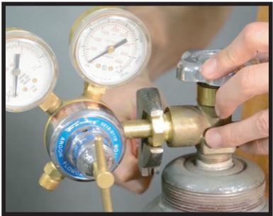 Attaching gas bottle and regulator hose assembly closeup