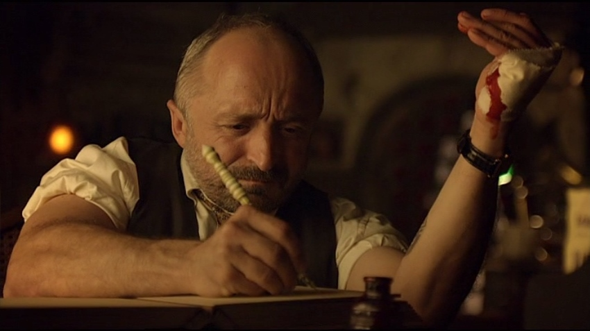 Trick writing in blood in Lost Girl 1x13