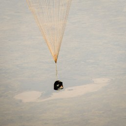 The Soyuz TMA-08M spacecraft with Expedition 36 Commander Pavel Vinogradov of the Russian Federal Space Agency (Roscosmos), Flight Engineer Alexander Misurkin of Roscosmos and Flight Engineer Chris Cassidy of NASA aboard, is seen as it lands in a remote area near the town of Zhezkazgan, Kazakhstan, on Wednesday, Sept. 11, 2013. Vinogradov, Misurkin and Cassidy returned to Earth after five and a half months on the International Space Station. Photo Credit: (NASA/Bill Ingalls)