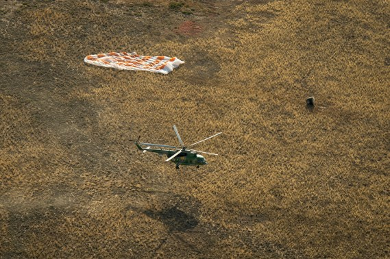 A Russian search and rescue helicopter lands just moments after the landing of the Soyuz TMA-08M spacecraft with Expedition 36 Commander Pavel Vinogradov of the Russian Federal Space Agency (Roscosmos), Flight Engineer Alexander Misurkin of Roscosmos and Flight Engineer Chris Cassidy of NASA aboard, in a remote area near the town of Zhezkazgan, Kazakhstan, on Wednesday, Sept. 11, 2013. Vinogradov, Misurkin and Cassidy returned to Earth after five and a half months on the International Space Station. Photo Credit: (NASA/Bill Ingalls)