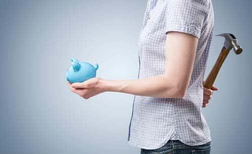 bigstock-Piggy-Bank-And-Hammer--Using--57830786