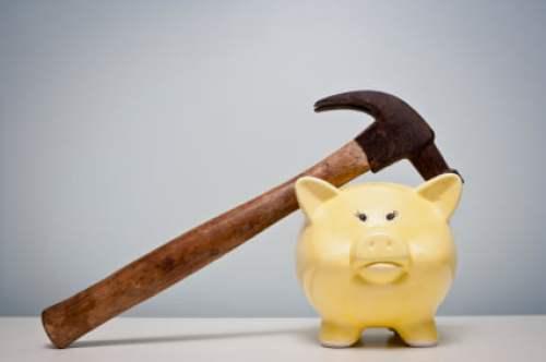 piggy bank and hammer