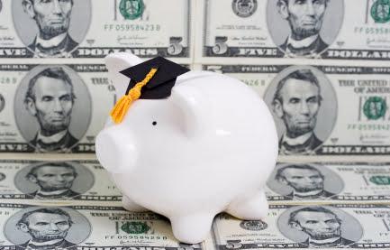 Piggy bank with a graduation cap