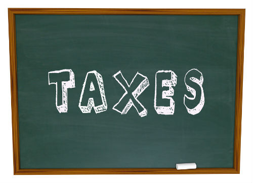 bigstock-Taxes-Word-Chalkboard-Figuring-56019530 2