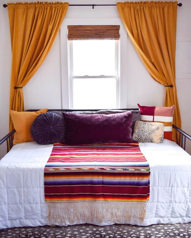 Daybed with dramatic curtains