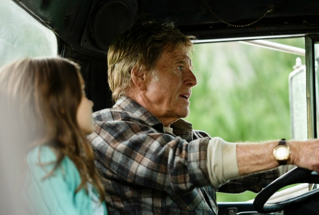 Robert Redford is Mr. Meacham and Oona Laurence is Natalie in Disney's PETE'S DRAGON, the story of a boy named Pete and his best friend Elliot, who just happens to be a dragon.