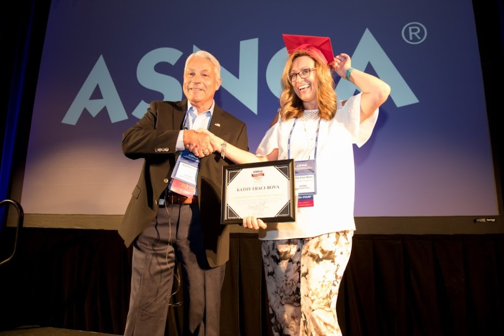 Raynold T. Petrocelli presenting a woman with an award