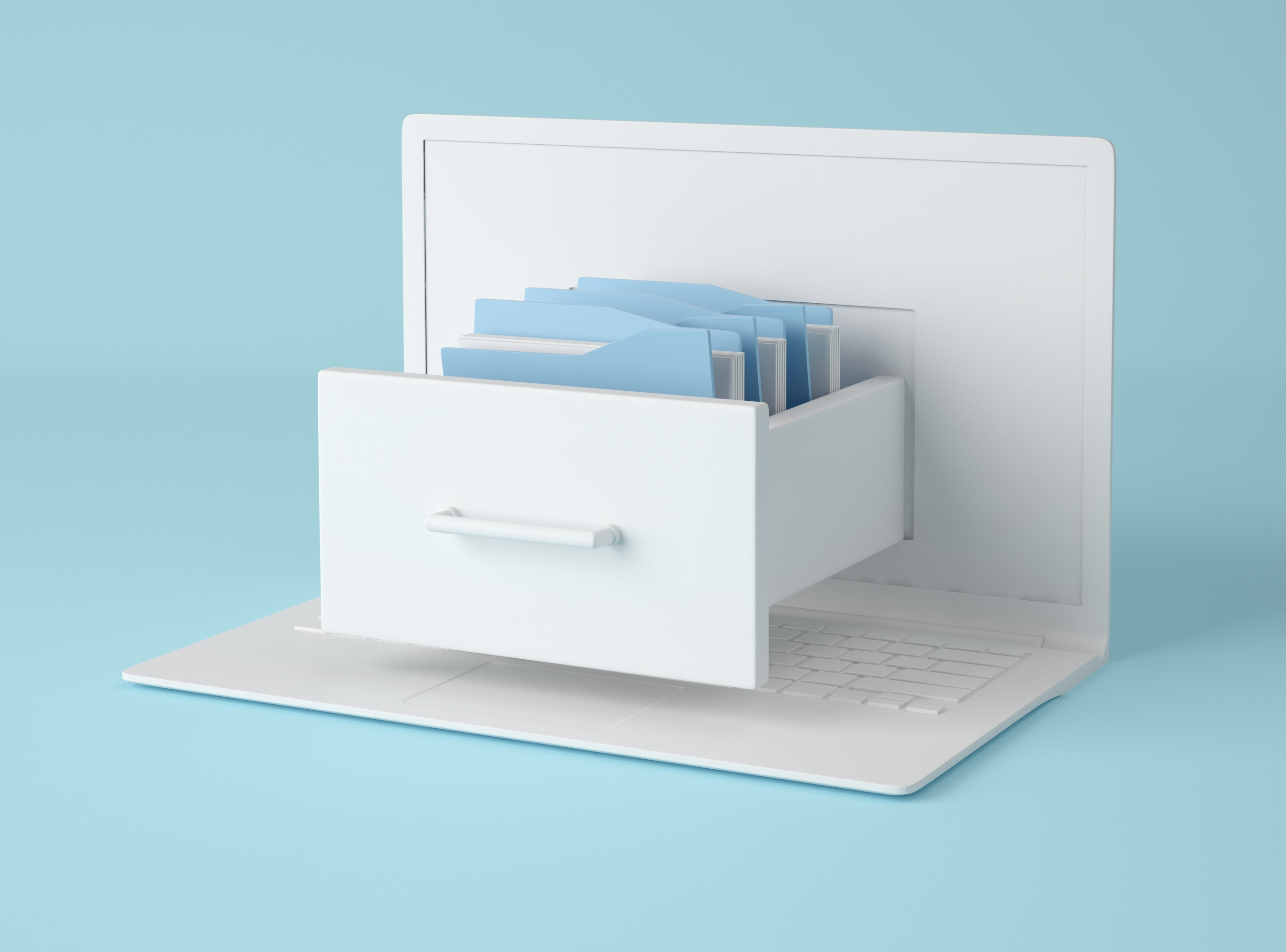 Computer laptop and file cabinet with folders.