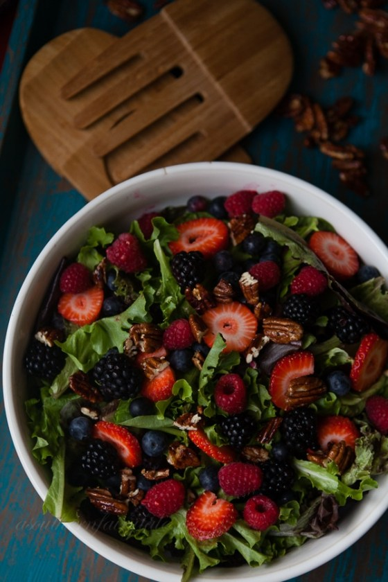 leafy green berry salad with honey glazed pecans
