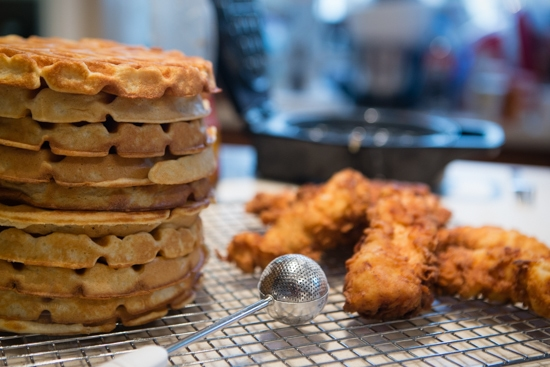 stack of buttermilk waffles and fried chicken