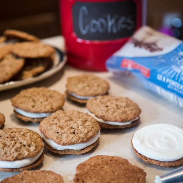 buttercream frosting filled homemade oatmeal cookies