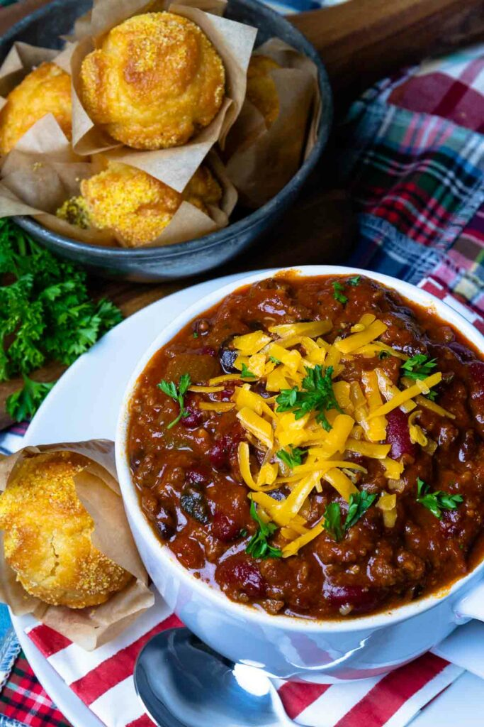 Award Winning Southern Soul Chili in a bowl with cheese and served with cornbread muffins is comfort food at it's best!