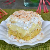 Pineapple Coconut Poke Cake is loaded with tropical flavor and easy to make. With a box cake mix, pudding, pineapple, cooking and whipped cream you can make this cake!