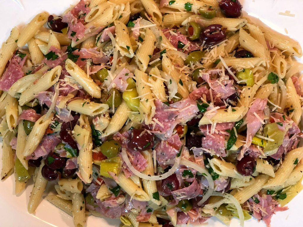 italian pasta salad, ham, olives, onion, salami and olive oil dressing