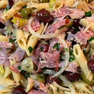 italian pasta salad with meats and cheese and olive oil dressing