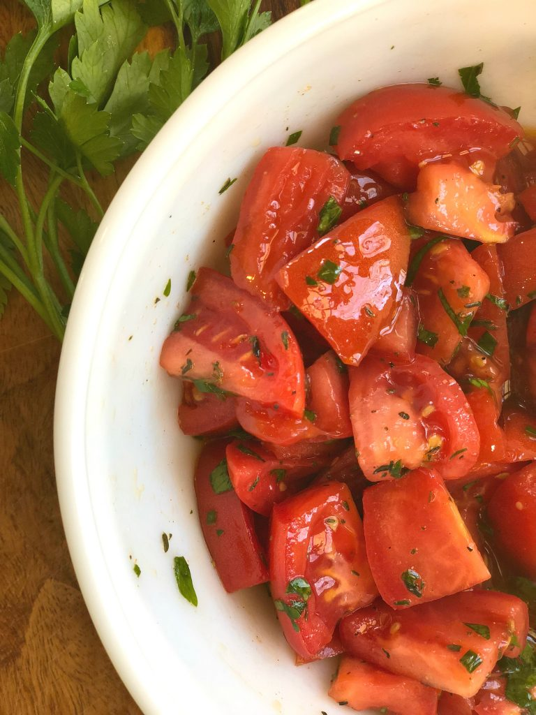 marinated tomatoes in a fresh herbal dressing
