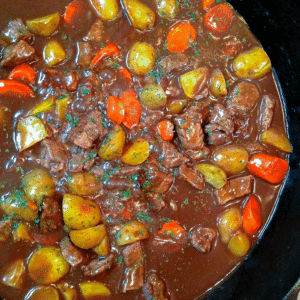 Beef Stew with carrots and potatoes cooked in a rich beef broth is made in 45 minutes in a cast iron skillet!