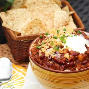 Rich, meaty chili made with Bloody Mary mix and two kids of beans is loaded with flavor that's sure to make the chili lovers in your life smile!