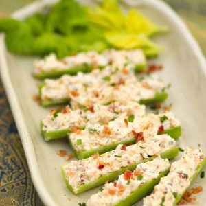 Celery stuffed with cream cheese, bacon, herbs and cheddar cheese are outrageously good! Served as an appetizer or snack, this is a recipe that's sure to become a favorite at parties, BBQs and family gatherings.