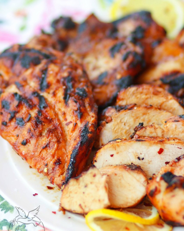 Sweet Heat BBQ Chicken made with your favorite BBQ sauce, Italian dressing, honey and red pepper flakes then grilled to perfection is a dish you'll make over and over again!