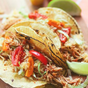 Shredded chicken cooked low and slow in the crock pot is flavored with taco seasoning and salsa. It's an easy to make recipe that great for tacos, nachos, burrito bowls and salads.