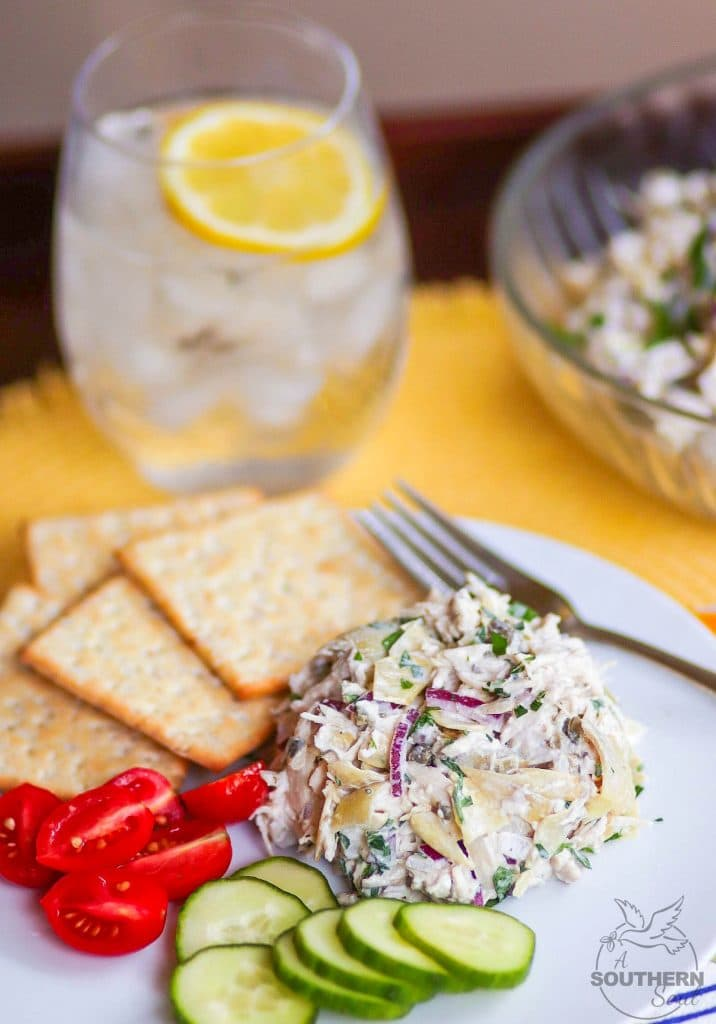 Artichoke Chicken Salad made with shredded white meat chicken, artichokes, capers and red onion tossed in a creamy, light, fresh dressing is a great new twist on a classic recipe!