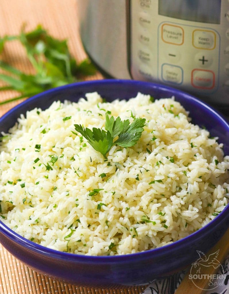 Rice made in the Instant Pot with garlic, fresh parsley and chives, along with butter is an easy to make side dish that turns out perfectly every time!