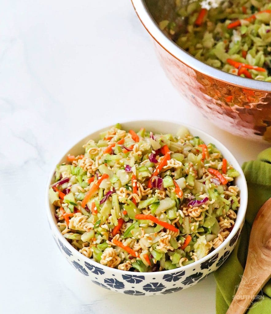 Ramen Broccoli Slaw made with toasted, packaged noodles, broccoli, carrots, green onion and a savory sweet dressing is a delicious side dish. Perfect for a weeknight meal, cookout, pot luck or covered dish supper.