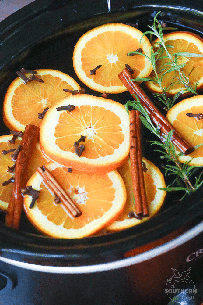 Fall Potpourri made in the crock pot with oranges, cinnamon, clove and rosemary fill your house with beautiful fresh scents.