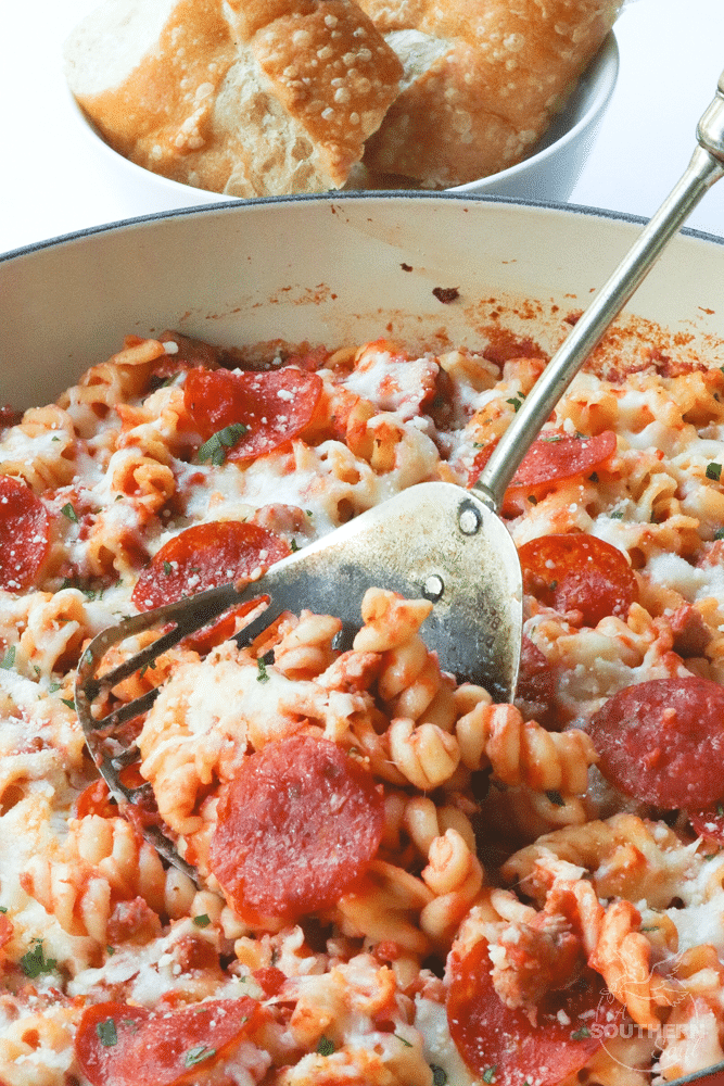 Pizza Pasta Bake is the perfect combination of all your favorite pizza flavors baked with tender pasta and cheese. It's a quick and easy main dish that everyone loves!