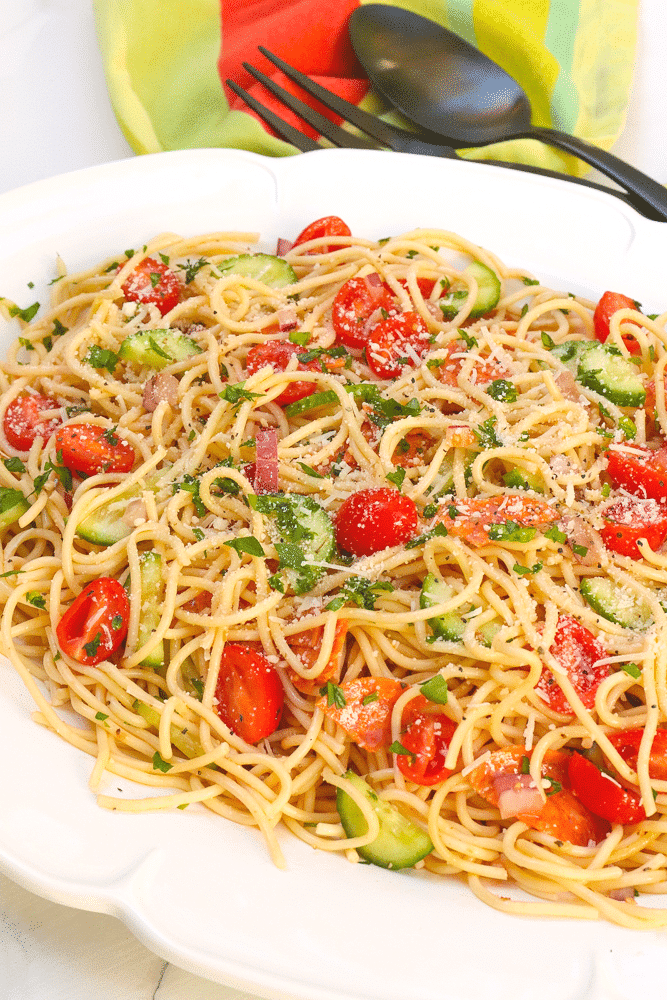 "Spaghetti Salad is the perfect side dish for a party, potluck or when you're feeding a crowd. Made with tender pasta, pepperoni, fresh veggies and tossed in a zesty dressing then topped with Parmesan cheese, this easy to make salad is ideal for ""soup and salad"" night!"