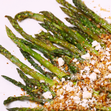 Roasted Asparagus topped with toasted Panko Breadcrumbs, Lemon and Feta cheese is a flavorful side dish that easy to make!