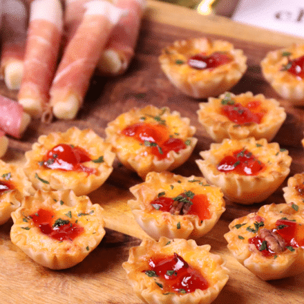 Crispy Phyllo cups filled with pimento cheese then topped with sweet, slightly spicy red pepper jelly makes for delicious appetizer for the holidays, game day or whenever you're entertaining!