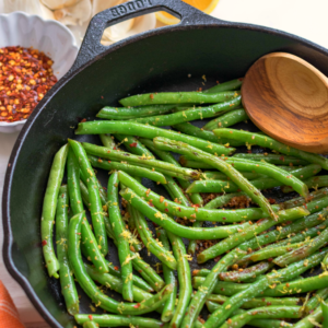 Skillet Green Beans made with garlic, lemon and red pepper is the ideal side dish for any meal! Simple and ready in 15 minutes!