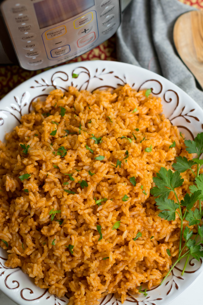 Instant Pot Mexican Rice made with white rice, tomato sauce, onions, cumin and chili powder is a great side dish for a weeknight meal or your next fiesta!