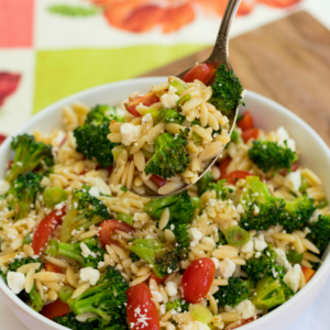Broccoli Pasta Salad is fresh, flavorful and easy to make! Orzo pasta, broccoli, grape tomatoes, green onion and, feta cheese toss in a light oil and vinegar dressing.
