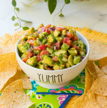Avocado Salsa made with fresh avocado, tomatoes, jalapenos, red onion then tossed in a light dressing of lime, olive oil, garlic powder, salt and pepper. This is the perfect dip to serve at your next party and it's also delicious served with fish or chicken.
