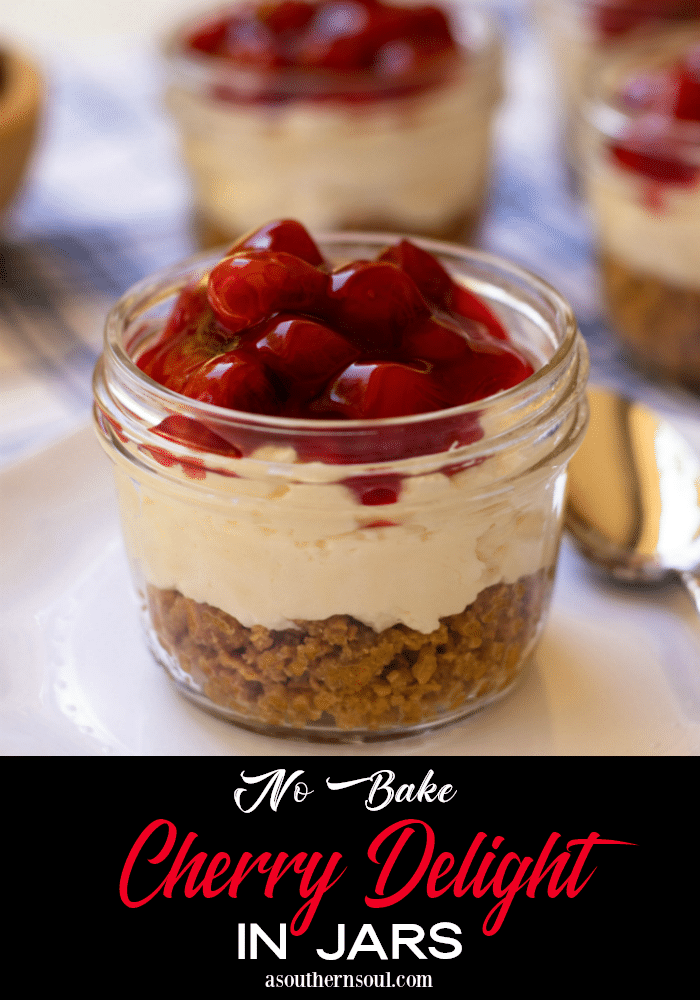 No Bake Cherry Delight In Jars is a yummy, easy to make dessert. A crust made with crushed graham crackers, butter and sugar is layered into small jars then topped with a mixture of cream cheese, powdered sugar and fresh whipped cream all topped with cherry pie filling.
