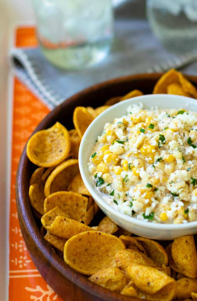 Mexican Corn Dip made with white and yellow corn, mayonnaise, sour cream, cojita cheese, canned green chilies, chicli powder, garlic, salt and cilanto. A yummy, easy to make appetizer servd with corn chips or tortillas.