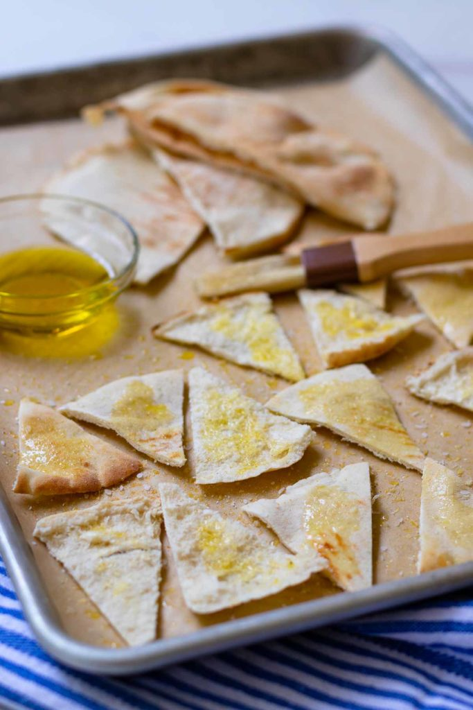 Homemade Pita chips made with store bought pita bread, olive oil, salt or za'atar. They are perfect for all your dips or for snacking.