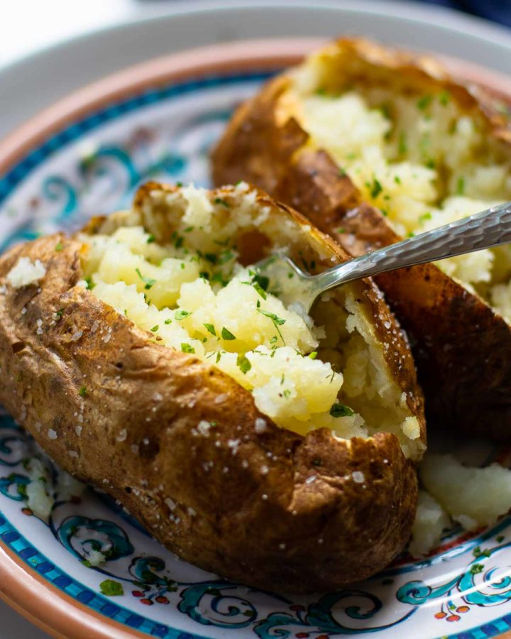 Baked Potatoes made in the Air Fryer are tender and fully on the outside with a crispy skin that makes them irresistible. Easy to make, just add your favorite toppings like butter, chives, sour cream, salt and pepper.